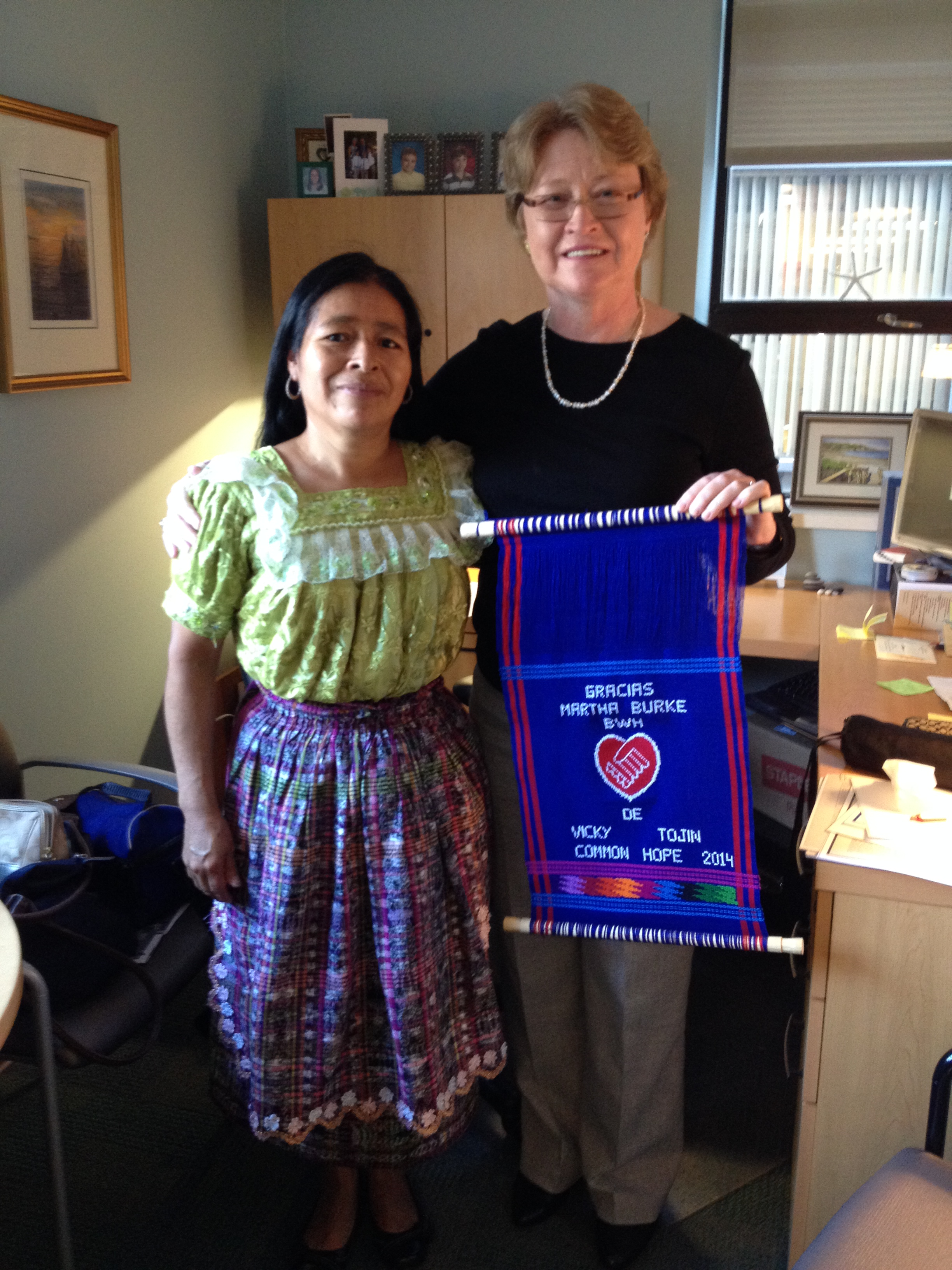 Martha Burke, LICSW received a gift from Visiting Scholar Vicky Tojin.