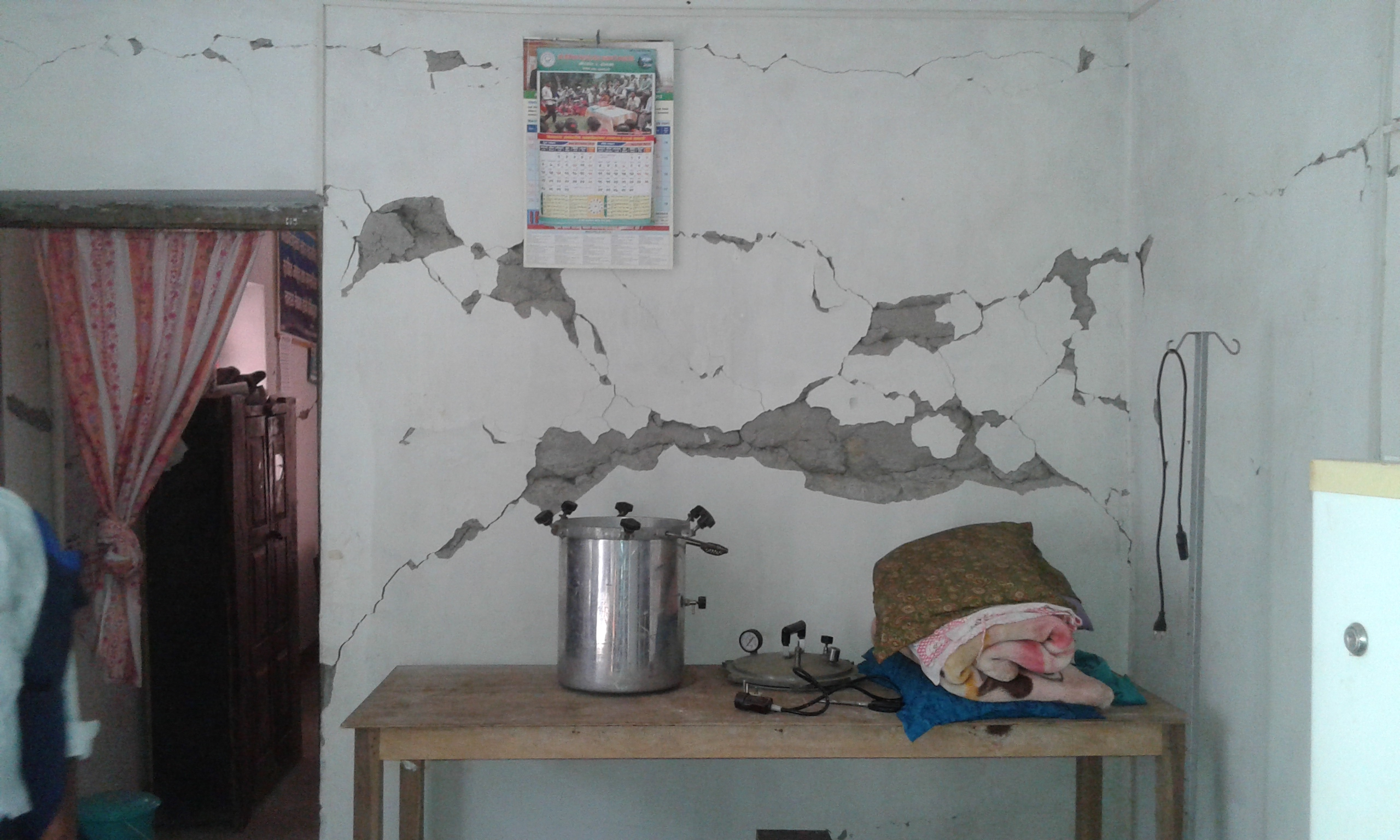 Cracked walls of the Bhirkot Health Post that was damaged during the earthquake and  will be one of the health posts rebuilt by Possible in 2015.