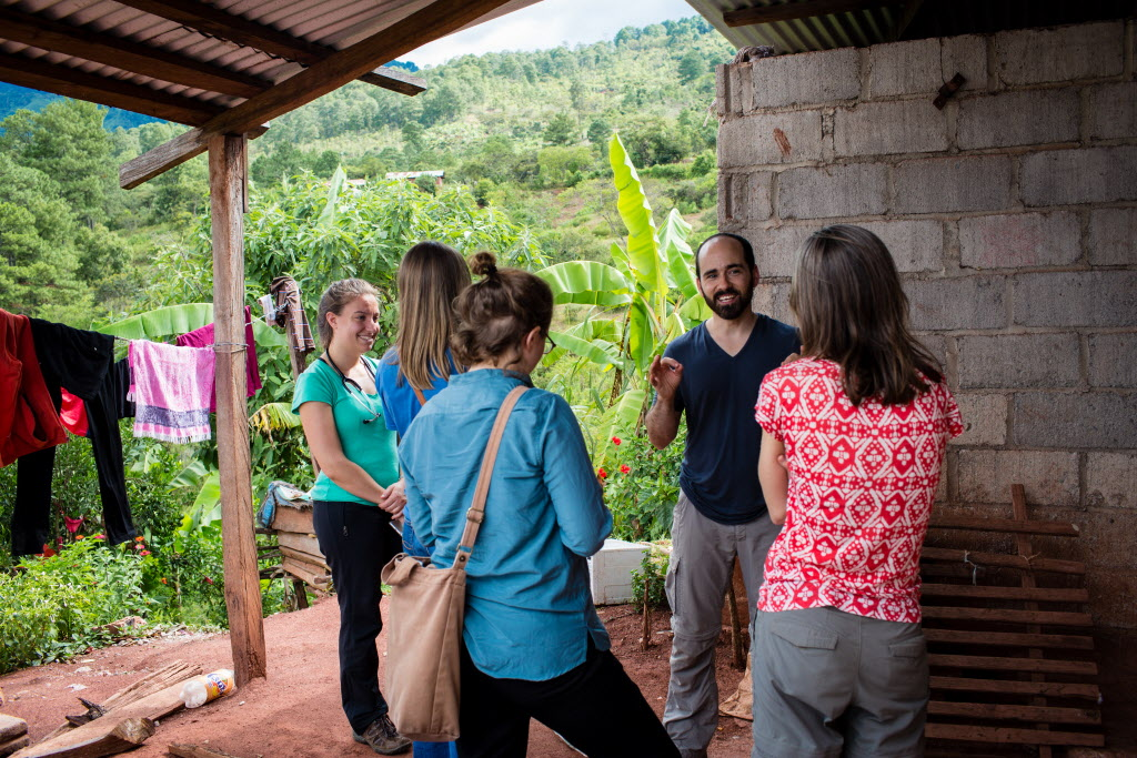 SOLEDAD, CHIAPAS, MEXICO - AUGUST 13, 2015: Dr. Dan Palazuelos, center, talks to bootcamp participants in the community of Soledad.  (Photo by Cecille Joan Avila / Partners In Health)