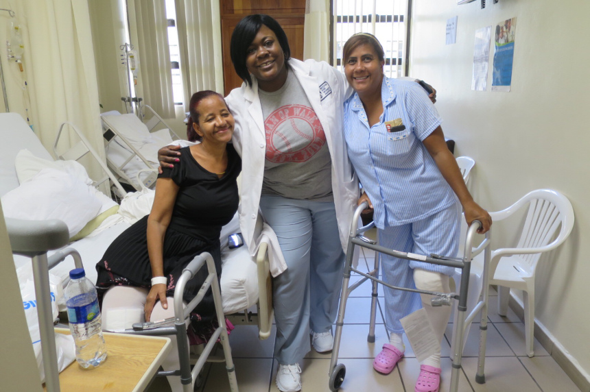 Kara Burge (center), a staff nurse in Orthopaedic Surgery, with two Operation Walk Boston patients